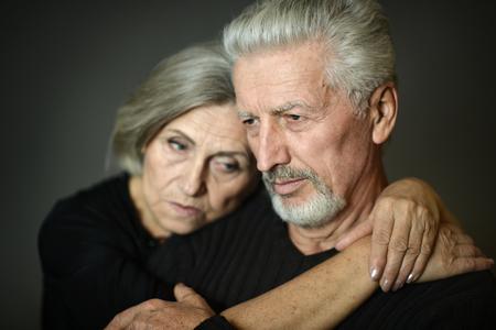 close-up portrait of senior couple on  background
