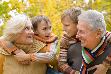 family with grandparents: Grandparents and grandchildren together in autumn park
