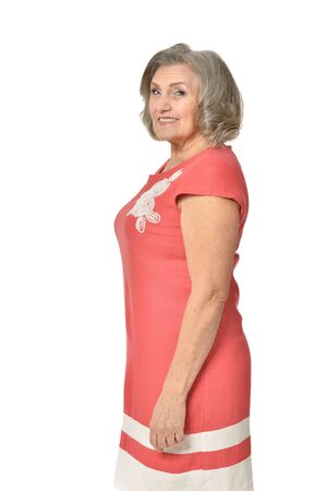 threw: Full length portrait of senior woman in red dress threw up his hands on white background