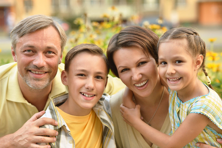 beautiful mom: happy family at summer green blooming field