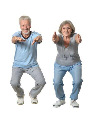 senior adults: Portrait of Senior Couple Exercising On White Background Stock Photo