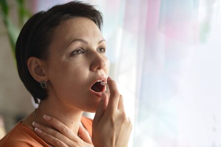 spay: Portrait of a young woman feels sickness Stock Photo