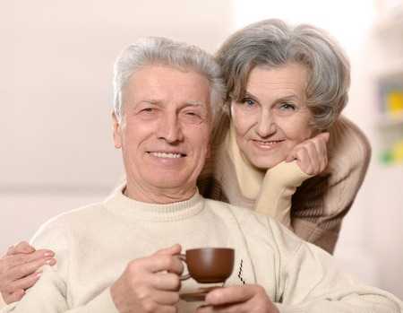 feeling happy: Happy beautiful older couple with coffee cup Stock Photo