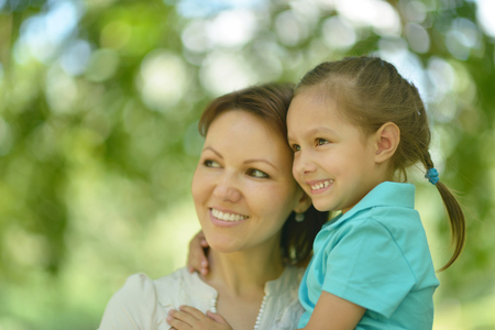 mam: Little cute girl with mother in park