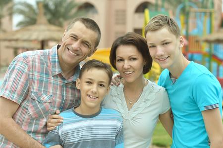 mam: Happy family having fun at tropical resort. Stock Photo