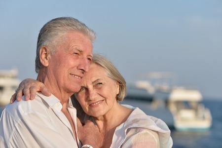 Portrait of a happy cute senior couple at sea