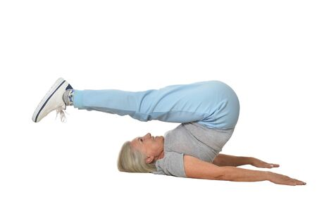 senior woman exercising: Senior woman exercising  on a white background