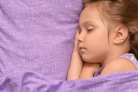 teen girl bedroom: Cute little girl sleeping in a bed