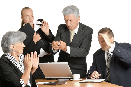 Businesspeople at work with laptop on white background