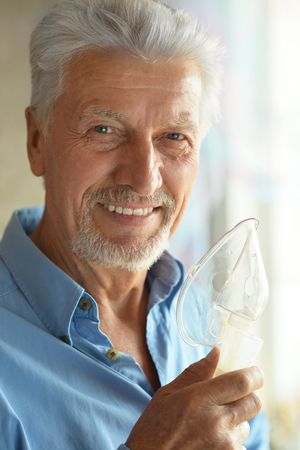 inhalation: Portrait of elderly man with flu inhalation