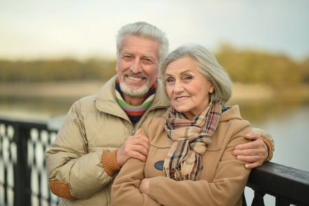 old couple walking: Portrait of a happy nice mature couple walking
