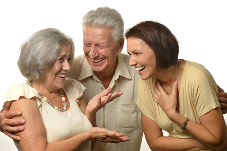 mam: Happy senior parents with daughter on background Stock Photo