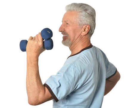 medical man: Portrait Of  Senior man Standing With Dumbbells On White Background