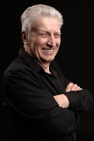 dult: Portrait of a happy smiling elder man Stock Photo