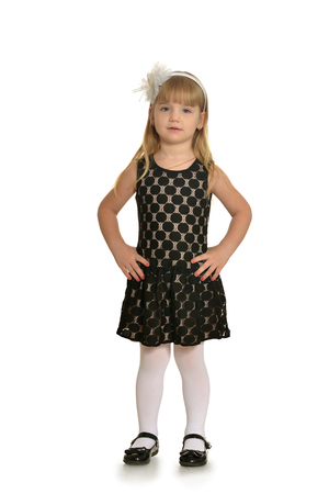 children clothing: Cute little girl in  dress smiling on camera with long hair