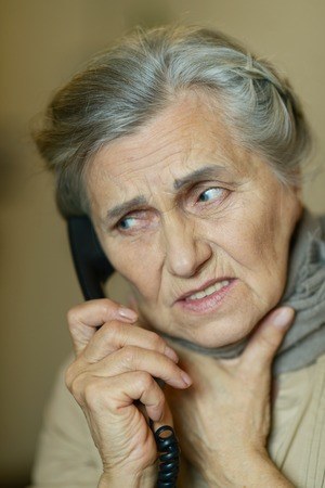 alling: Portrait of a senior woman calling her doctor Stock Photo