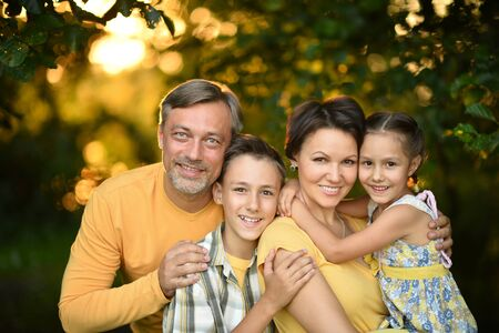 families together: Happy Family resting in a summer park Stock Photo