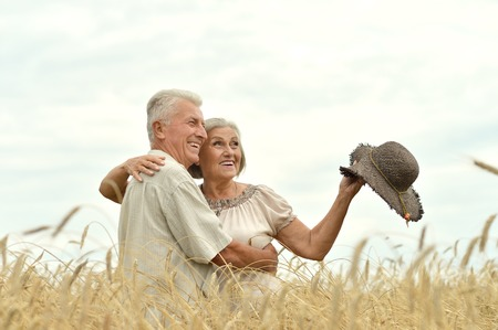 active seniors: Portrait of a senior couple resting at summer field