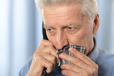 tooth pain: Sick old man with tooth pain call a doctor Stock Photo
