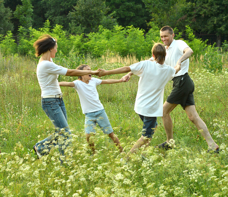 4 of a kind: Good family having fun in the company of each other on the nature