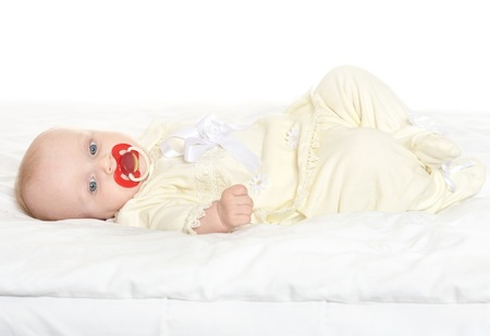 nipple girl: Adorable baby girl on blanket with nipple on a white background