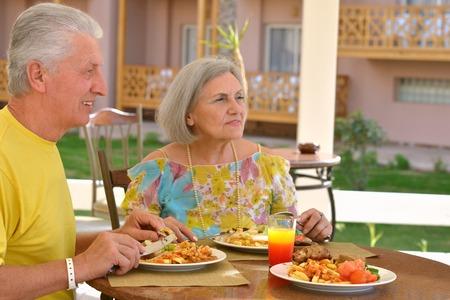 Happy mature couple eating dinner at restaurant Reklamní fotografie