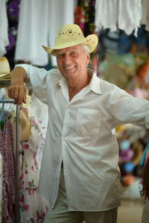 good grooming: Portrait of a nice mature man in hat in shopping center Stock Photo