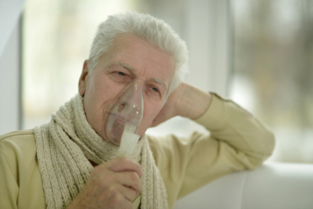 inhalation: Portrait of elderly man with flu inhalation
