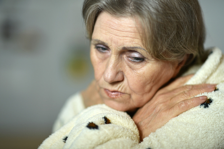 fells: Portrait of mature woman fells ill at home