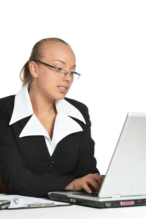 butch: Young secretary sitting at table with laptop Stock Photo