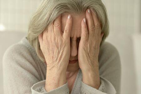 amiable: Portrait of a sad senior woman close up