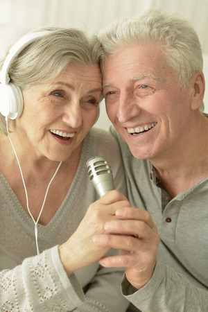 amiable: Portrait of a senior couple with headphones and microphone