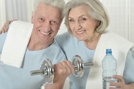 amiable: Portrait of a happy sporty senior couple exercising Stock Photo