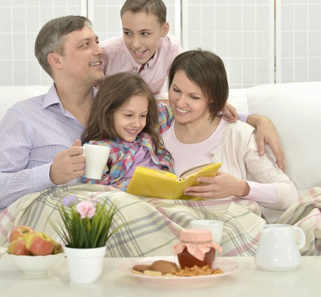 family  room: Happy family  in a room reading book