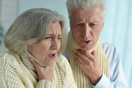 senior adult man: Portrait of a ill senior couple close up