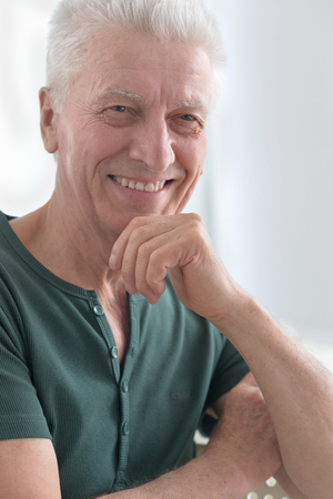 amiable: Portrait of a happy senior man face