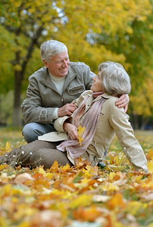 old man happy: Senior couple have a walk in autumn forest