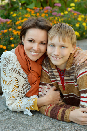 mam: mother and son on a walk  in the park Stock Photo