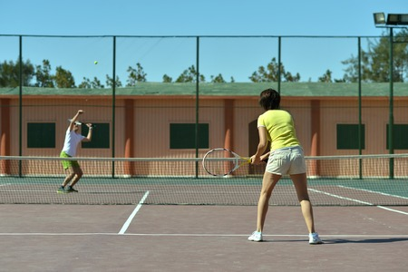 agility people: Portrait of a happy tennis players court Stock Photo
