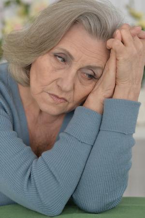 melancholy: Portrait of a melancholy senior woman close up