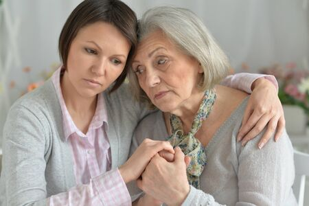miserable: miserable senior mother and adult daughter together