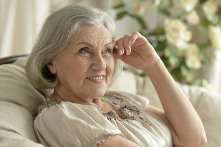 Portrait of a happy senior woman resting at home Stock Photo