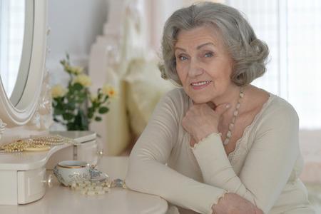 happy Senior woman portrait with jewelry box