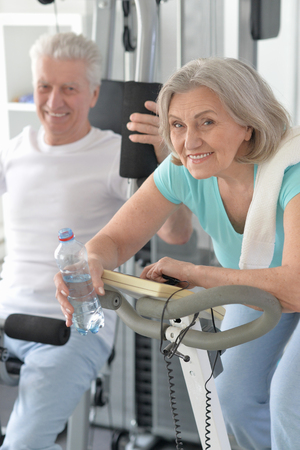 Portrait of a happy sporty senior couple exercising Stock Photo