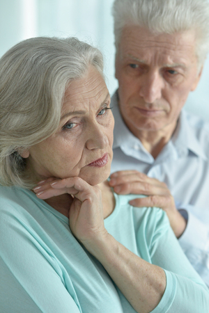 melancholy: Portrait of a melancholy senior couple close up Stock Photo