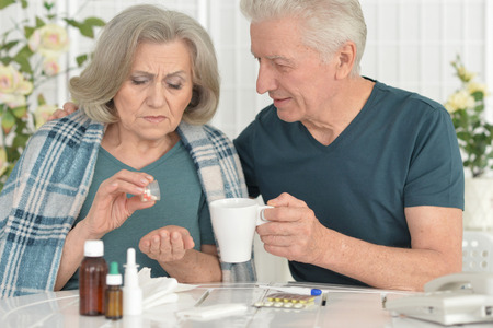 amiable: Portrait of a ill senior woman with caring husband Stock Photo