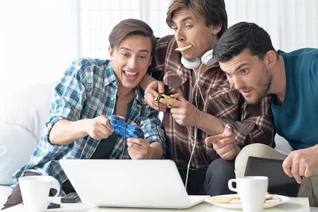 Portrait of young men playing computer games