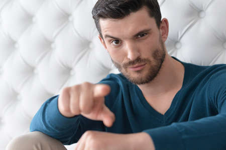 need direction: man in a casual style pointing on you Stock Photo