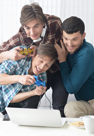 computer games: Portrait of a young men playing computer games Stock Photo