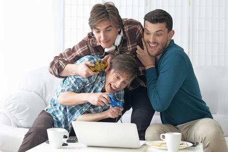 Portrait of a young men playing computer games Reklamní fotografie